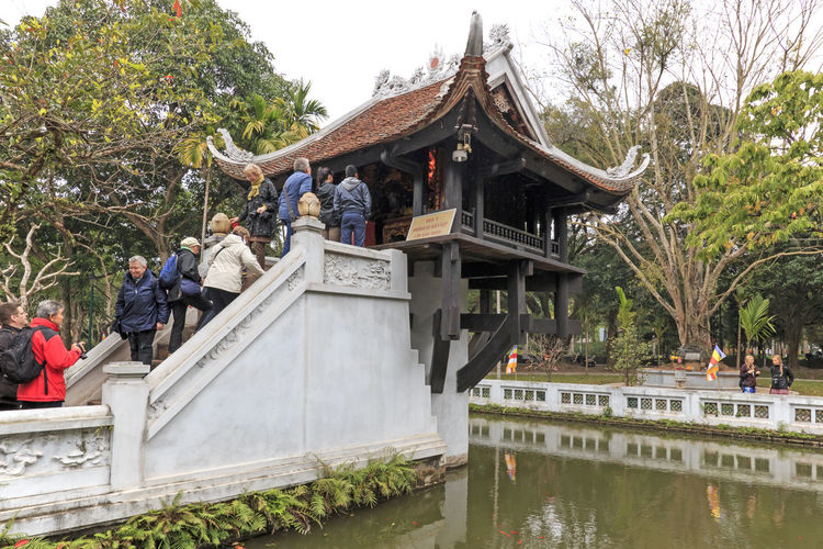 Hanoi, Vietnam - February 23, 2016: Tourists visiting the One Pillar Pagoda of Hanoi in Vietnam Architecture Built Structure Culture Day Gazebo Growth Hanoi Hanoi Vietnam  Ho Chi Minh Mausoleum Nature No People Old Town One Pillar Pagoda Outdoors Place Of Worship Plant Sky Spirituality Temple Temple - Building Tourists Travel Destinations Tree Vietnam Water