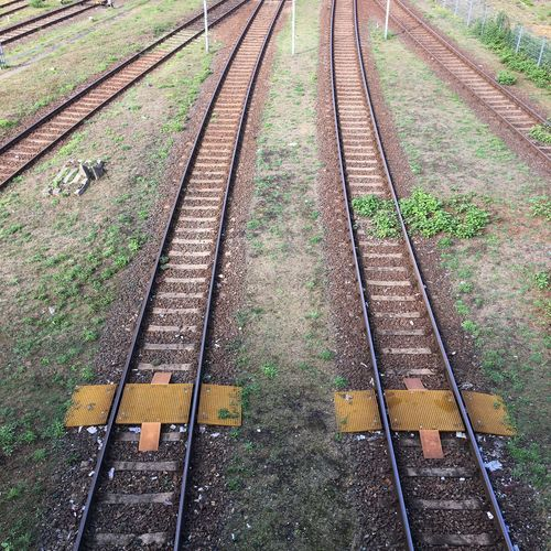 Railroad Track Rail Transportation Transportation Public Transportation Railway Track Metal The Way Forward Straight Travel Outdoors Diminishing Perspective Gravel Train Track Track Parallel Surface Level Vanishing Point Green Color Berlin Different Directions
