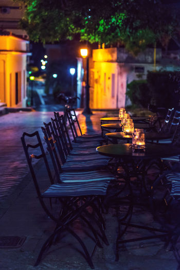 Architecture Built Structure Chair Coffee Empty Illuminated In A Row Night No People Outdoors Table