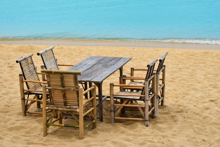 Chairs on table at beach