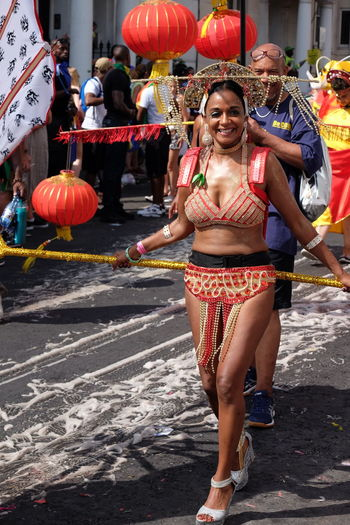 Dancer, Nottinghill Carnival Chinese Lanterns Composition Dancing Fun GB London Looking At Camera Portrait Of A Woman Silk Road Capital City Carnival Costume Front View Full Frame Full Length Fun Hanging Happiness Incidental People Nottinghill Carnival 2017 One Person Outdoor Photography Red Colour Smiling Face Sunlight And Shadows Uk
