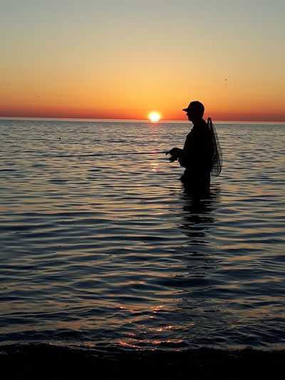 Gone fishing Gone Fishing Sunset_collection Sunset Silhouette One Person One Man Only Outdoors Tranquility Sky Fishing Water Nature Reflection Sea Baltic Sea Seatroutfishing Sun Fisherman Fehmarn Beauty In Nature Clear Sky Horizon Over Water Cloud - Sky Beach Live For The Story