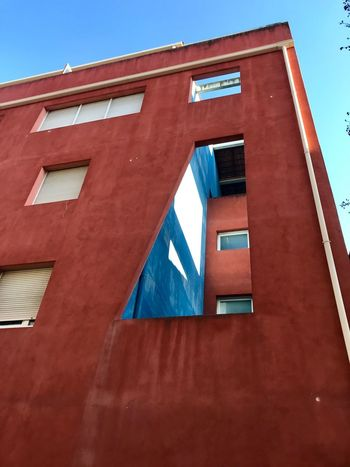 Trouée Architecture Building Exterior Built Structure Red Low Angle View No People Day Blue Window Building Façade Wall