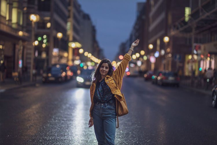 Architecture Beautiful Woman Building Exterior Casual Clothing City City Life City Street Focus On Foreground Front View Illuminated Lifestyles Looking At Camera Night One Person Outdoors Portrait Road Standing Street Young Adult Young Women A New Beginning EyeEmNewHere Analogue Sound Streetwise Photography