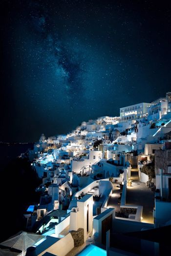 High angle view of buildings at night