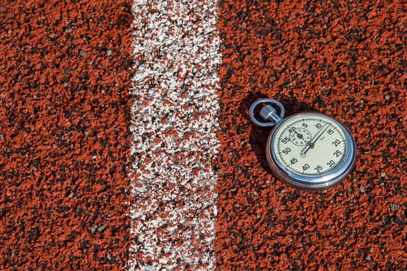 Close-up of stopwatch on field