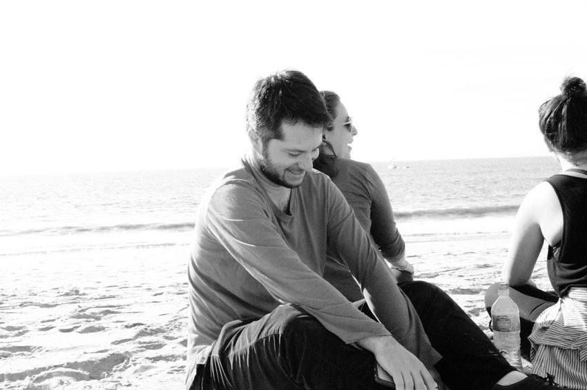 photo shy #Blackandwhitephotography #blackandwhite #beach Sea Beach Two People Adult Men Sitting Togetherness Relaxation Leisure Activity Nature Outdoors Water Sand Horizon Over Water People Vacations