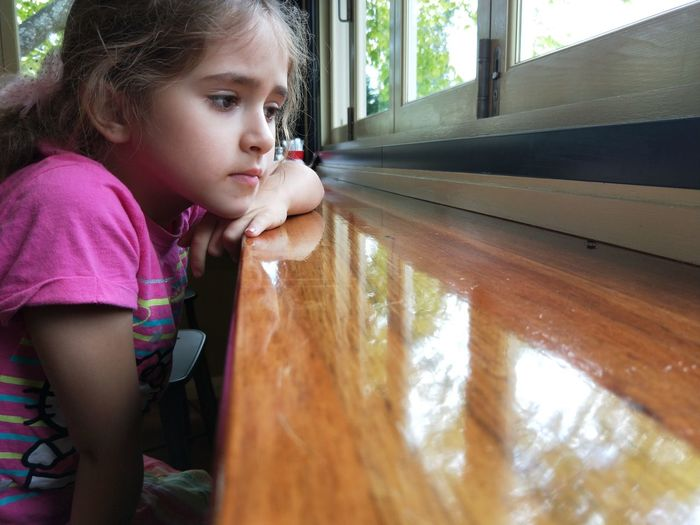 Observing Fly Insect Fly - Insect Watching Table Sad Sadness Sorrow Contemplating EyeEm Selects Child Childhood Girls Looking Through Window Window Space Curiosity Close-up Thoughtful Thinking Day Dreaming Blank Expression Pensive Introspection