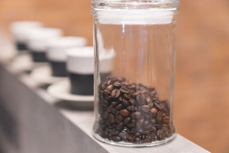 Aroma Away Coffee Background Bean Beans Beverage Black Break Breakfast Brown Cafe Caffeine Close-up Closeup Coffee Container Copy Space Cup Cups Dark Drink Energy Equipment Espresso Food Fresh Glass Grain Hot Isolated Jar Kitchen Lid Morning Mug Natural Paper Plastic Preparation  Roast Roasted Rustic Seed Table Take Taste Texture Vintage White Wooden Roasted Coffee Bean