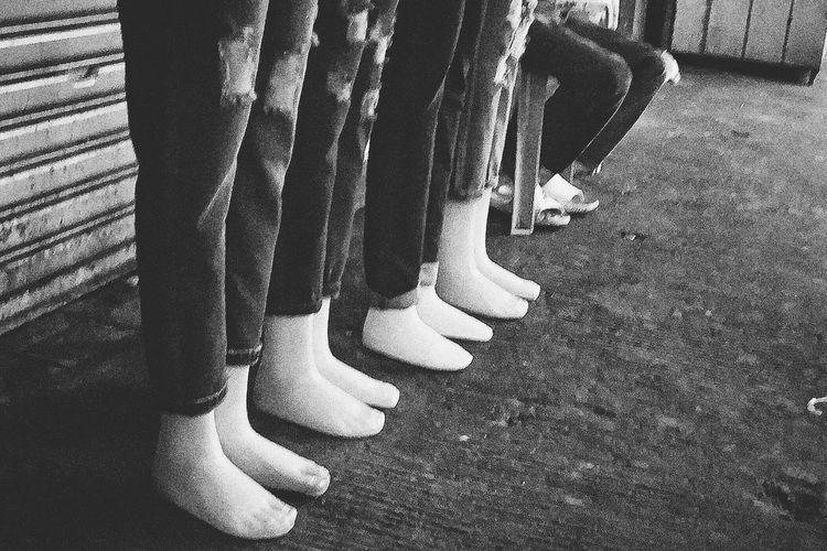 Ten feet low 10 Low Section Men Standing Human Leg Shoe Human Foot Close-up