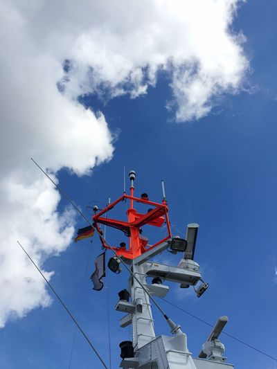 Low angle view of lifeboat mast against sky