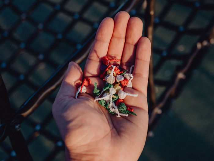 Close-up of cupped hand holding firecrackers