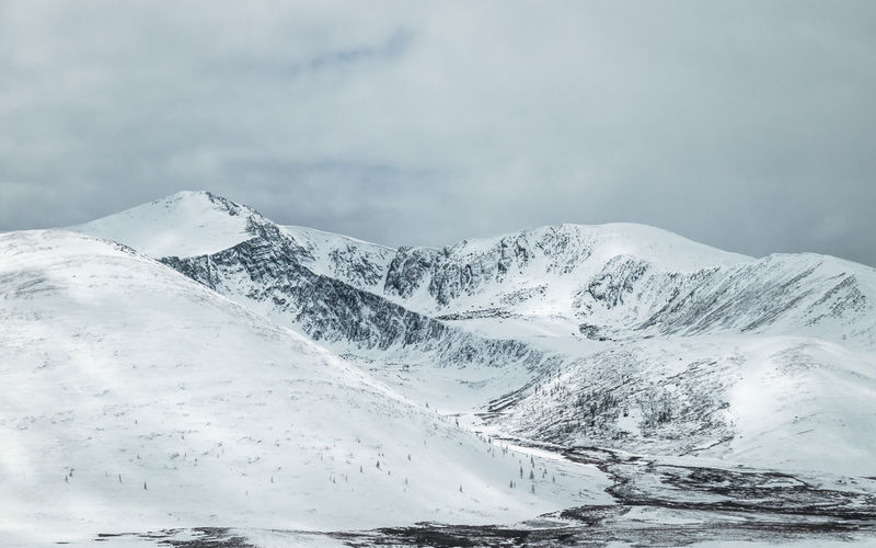 Mongolia Snow Cold Temperature Winter Mountain Beauty In Nature Snowcapped Mountain Scenics - Nature Sky Cloud - Sky Tranquil Scene Non-urban Scene White Color Tranquility No People Environment Day Landscape Nature Mountain Range Extreme Weather Range Mountain Peak