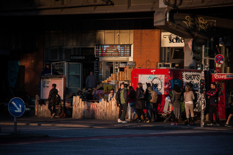 People at store in city