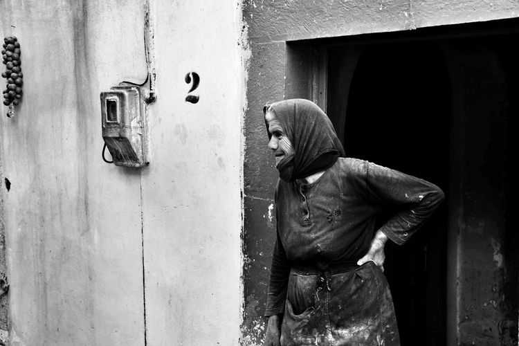 Blackandwhite Elderly Woman Real People Standing One Person Door Women People Village Life The Week On EyeEm EyeEm Best Shots Nikonphotography EyeEm Gallery Malephotographerofthemonth Hood - Clothing Women Who Inspire You Women Around The World Old But Awesome Real Life Blackandwhite Photography Hands At Work Mastiha Lifestyles Building Exterior Getting Inspired