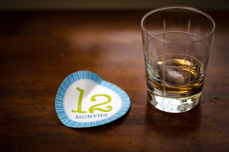Label with number 12 by whiskey on table