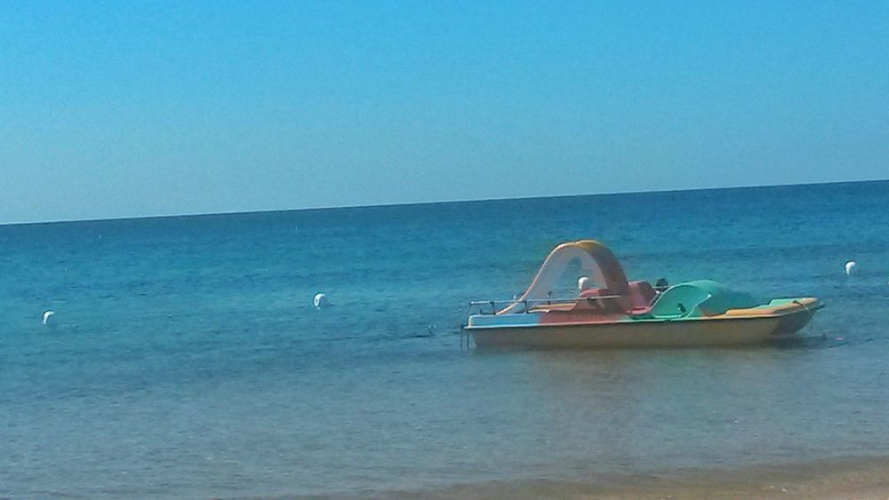 Water Sea Floating On Water Horizon Over Water Nature Nautical Vessel Outdoors Clear Sky Sky No People Holiday Vacation Summer Poetto Poettobeach Poetto Beach Sardegna Sardinia Sardinia Sardegna Italy  Pedalo Pedalo With Slide Pedal Boat
