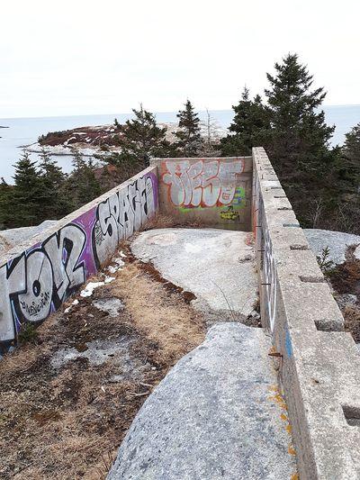 Graffiti on wall against clear sky