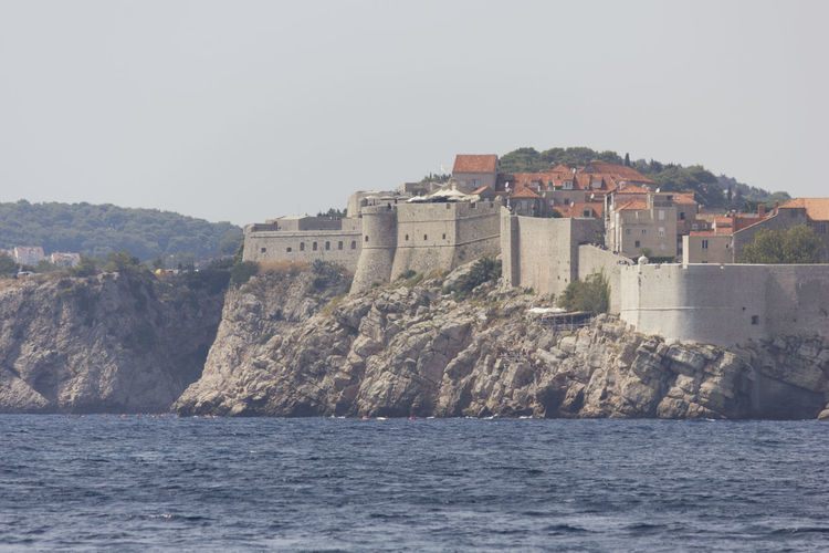 Dubrovnik Dubrovnik, Croatia Croatia Outdoors Cliff Cliffside Walls Fortified Wall Fortified Walls Cityscape Water Sky Waterfront The Past Architecture History Clear Sky Nature Building Sea Built Structure Building Exterior Travel Day No People Mountain Travel Destinations Copy Space Fort View Into Land