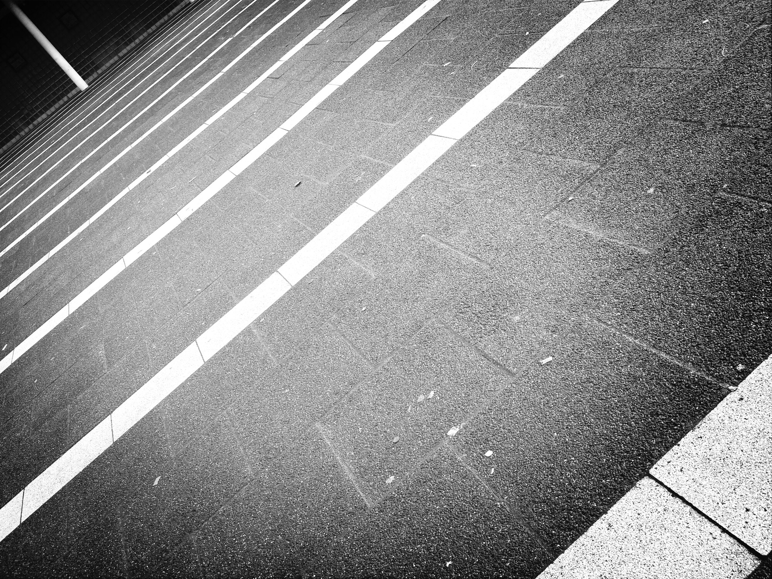 road marking, street, asphalt, transportation, road, high angle view, zebra crossing, the way forward, outdoors, full frame, sidewalk, day, pattern, no people, textured, sunlight, guidance, backgrounds, shadow, direction