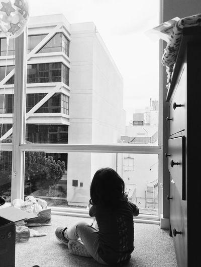 Man on window in city