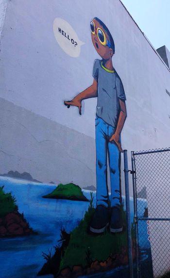 Toronto street art EyeEmNewHere Contrasting Colors Murals Hello Boy Artistic Expression Graffiti Art Visual Communication Neighbourhood Street Art Urban Landscape Explore Your City Painted Wall Toronto Street Photography Streets Of Toronto Standing Full Length Day Outdoors Blue