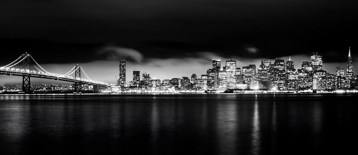 San Fransisco City At Night Nightphotography San Francisco Architecture Black And White Bridge - Man Made Structure Building Exterior Built Structure City Cityscape Connection Downtown District Illuminated Modern Night No People Outdoors River San Francisco Bay Sky Skyscraper Suspension Bridge Travel Destinations Urban Skyline Waterfront