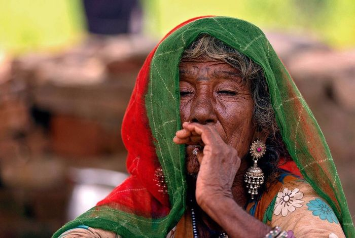 live life queen size !! Rajasthani Culture Tribal Old-fashioned Smoking Women Smoking People Mature Adult Only Women Headshot Focus On Foreground Lifestyles Real People Portrait Human Face Close-up Outdoors Day An Eye For Travel Inner Power
