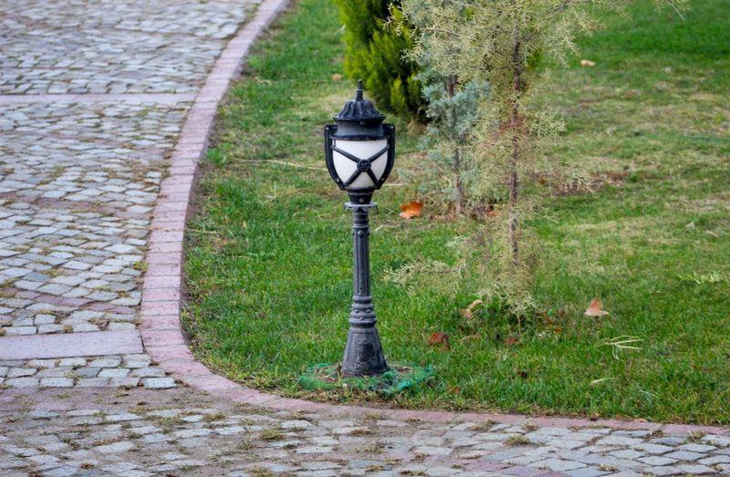 Street light by footpath in park