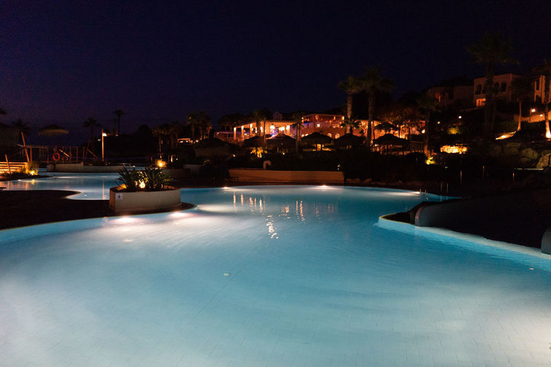Dark Light Lights Nightphotography Swimming Architecture Blue Building Exterior Built Structure City Clear Sky Dusk Illuminated Lighting Equipment Nature Night No People Outdoors Pool Poolside Reflection Sky Swimming Pool Water Waterfront