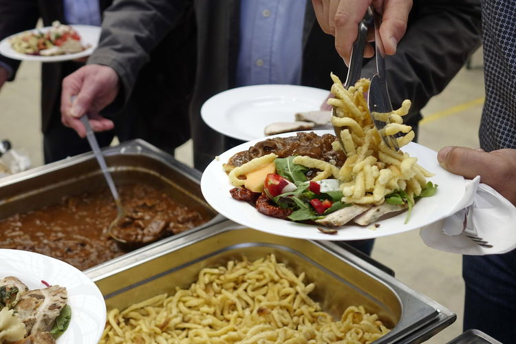 Catering Food Close-up Day Food Food And Drink Freshness Holding Human Body Part Human Hand Indoors  Lifestyles Men Midsection People Plate Ready-to-eat Real People