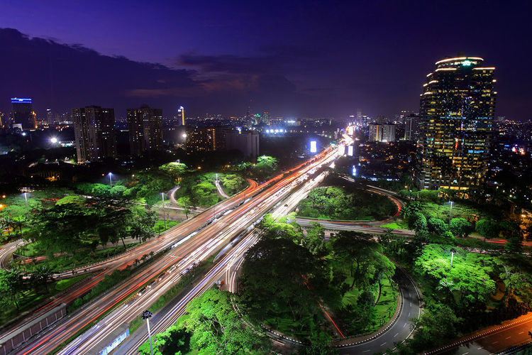 Architecture City City Life Cityscape Elevated View Illuminated Light Trail Modern Night Outdoors Sky Tree