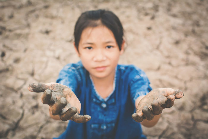 Asian  Drought Earth Hope Hot Land Life Nature Broken Change Child Climate Concept Crack Environment Girl Ground Heat Human Kid Outdoor Sad Shortage Soil Water