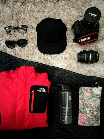 Once upon a time when you only got carry on to pack for two different seasons. Definitely a packing challenge! No People Glasses Sunglasses Flatlay Outdoor Clothing Camera Canon Lenses Canon Lenses Travel Packing My Suitcase Packing Let's Go. Together.