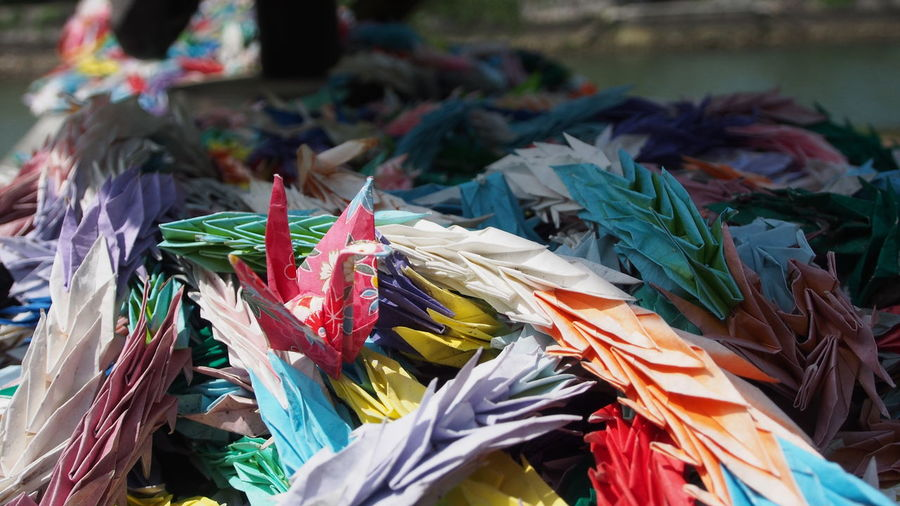 Multi colored papers crafts on sunny day