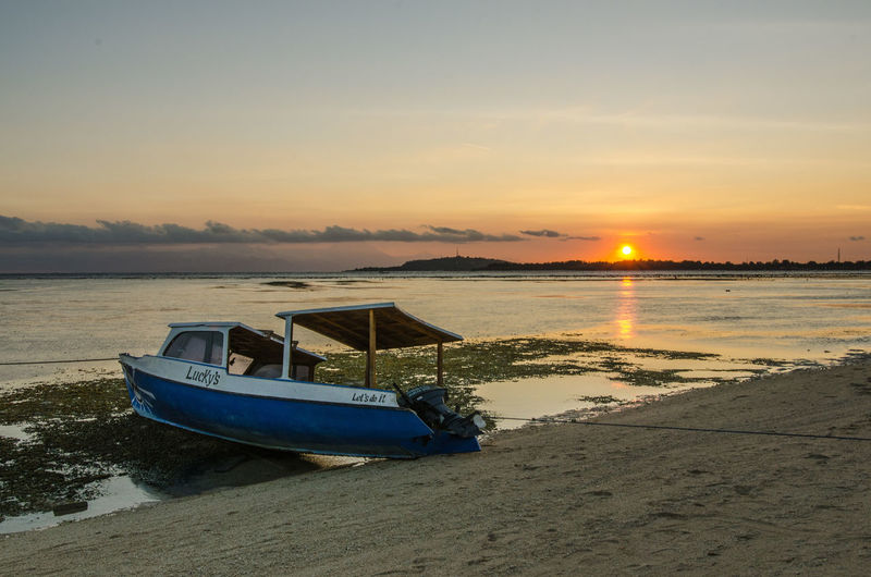Beauty In Nature Boat Cloud Cloud - Sky Gili Gili Air Sunset Beach Idyllic Mode Of Transport Nature Nautical Vessel No People Non-urban Scene Orange Color Outdoors Remote Scenics Sea Shore Sky Sun Sunset Tourism Tranquil Scene Tranquility Water