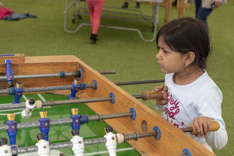 Cute girl playing foosball