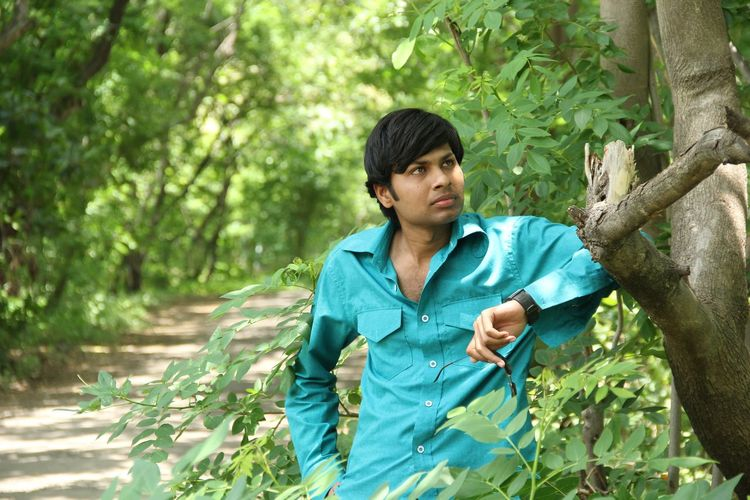 Portrait of a young man in forest