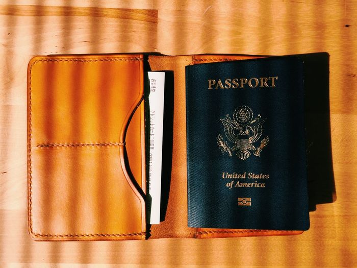 High angle view of passport on table