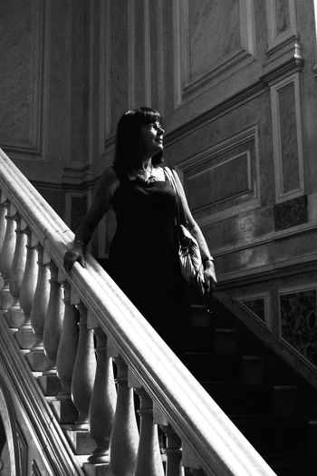 Low angle view of woman standing on steps