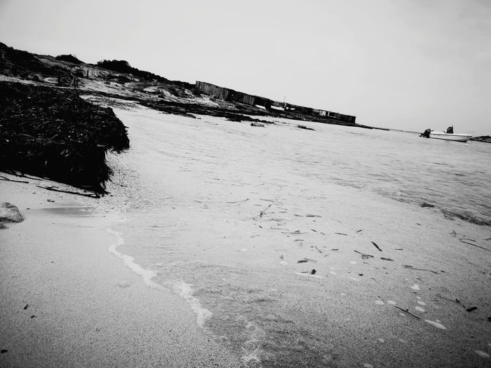 EyeEmNewHere EyeEm Best Shots Black & White Desolation Seascape Cloudy Spectacular View Water Sea Beach Sand Photography Themes Wave Sky Horizon Over Water Coastal Feature Seascape Fishing Boat Summer In The City