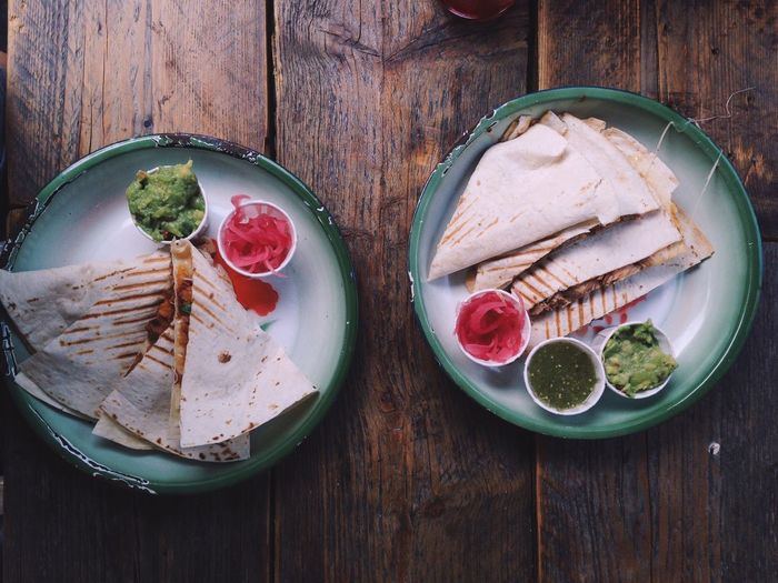 High Angle View Of Quesadilla In Plate On Wooden Table