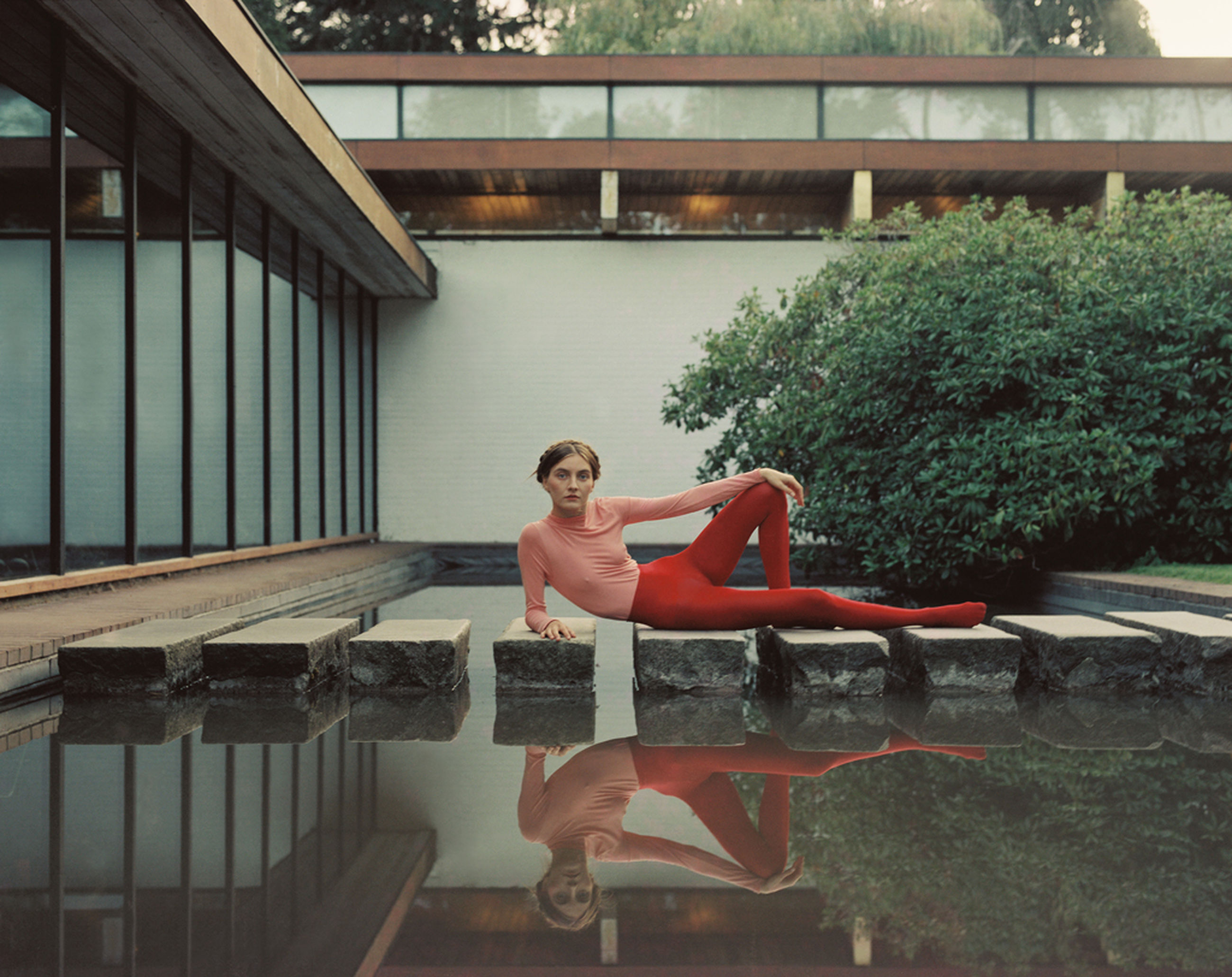 full length, one person, real people, leisure activity, young adult, lifestyles, architecture, young women, built structure, water, day, nature, women, plant, clothing, sitting, outdoors, swimming pool, beautiful woman