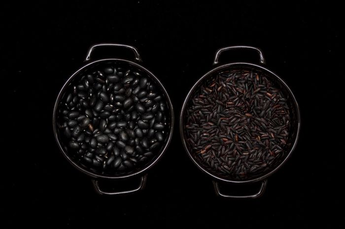 black beans and black rice in two black bowls on a black background Beans Black Background Black Bean Black Beans Black Rice Close-up Directly Above Freshness No People Raw Food Rice