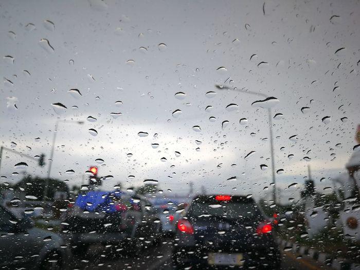 The car has crashed. Way Slow The Car Has Crashed. Car Cradhed Rain Water Drop Water Backgrounds Drop Wet Car Window Sky Close-up RainDrop