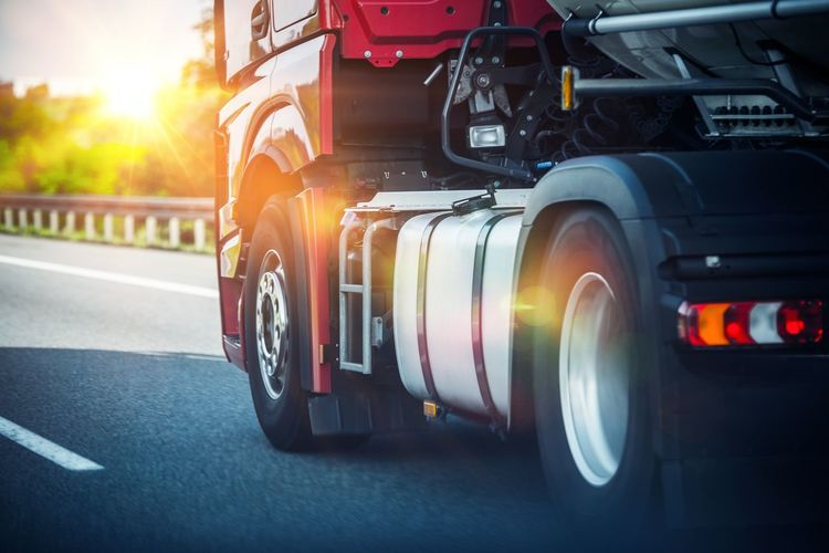 Euro Semi Truck on the Highway. Semi Truck Heavy Duty Transportation Car Cargo City Close-up Day Land Vehicle Lens Flare Mode Of Transportation Motion Motor Vehicle Nature No People Outdoors Road Shipping  Speed Street Sunlight Tire Transportation Truck Trucking Wheel