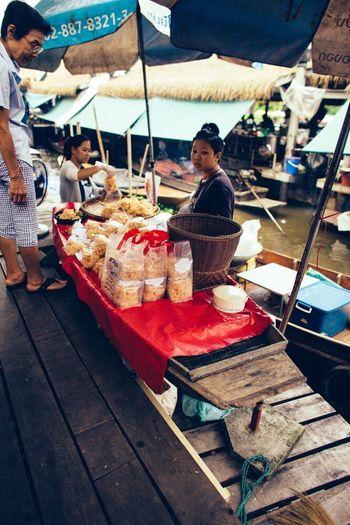 People sitting at market