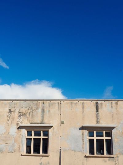 EyeEm Selects Architecture Sky Built Structure Building Exterior Blue Building Window Low Angle View Day Cloud - Sky No People Sunlight House Wall - Building Feature