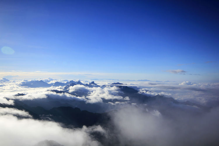 Fansipan In Sapa in Vietnam Above Aerial View Beauty In Nature Blue Cloud - Sky Cloudscape Copy Space Day Environment Fluffy Idyllic Majestic Meteorology Nature No People Outdoors Scenics - Nature Sky Softness Tranquil Scene Tranquility White Color