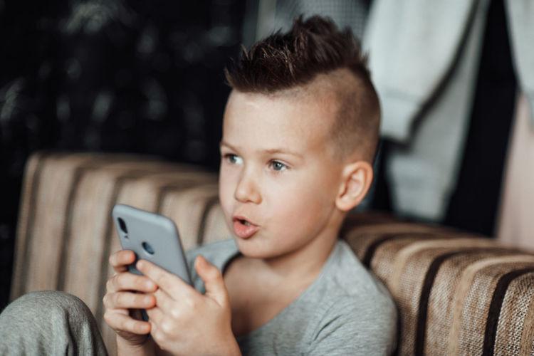 Baby boy using mobile phone